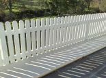 White fencing with rounded tops